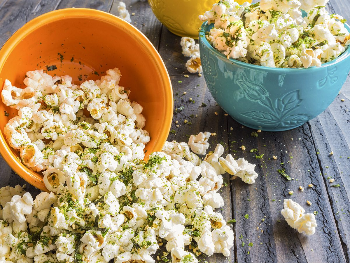 Healthy snacks, bowls of popcorn flavoured with spices