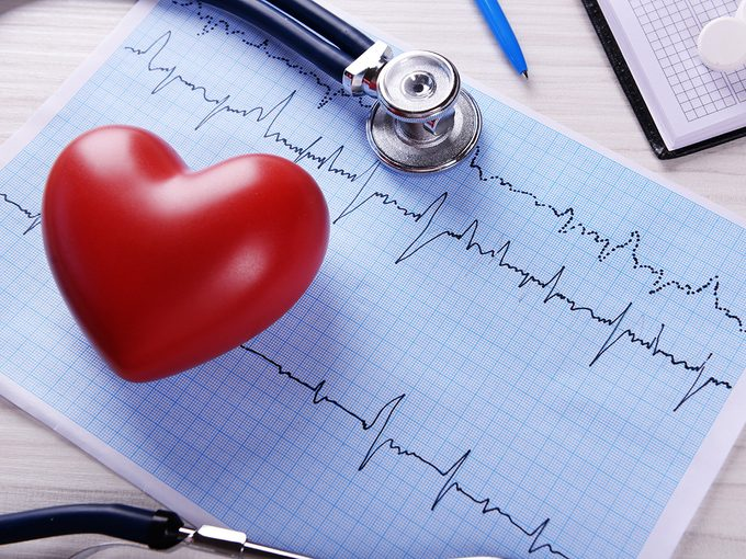 Heart disease, cardiogram results, a red heart and a stethoscope
