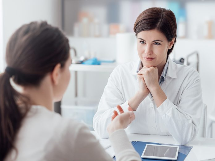 A woman consults her doctor about heartburn