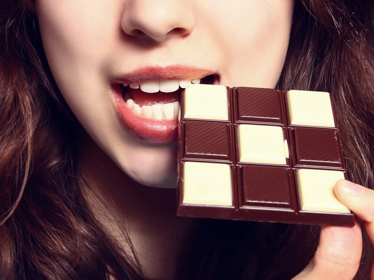 Intelligence, woman eating chocolate