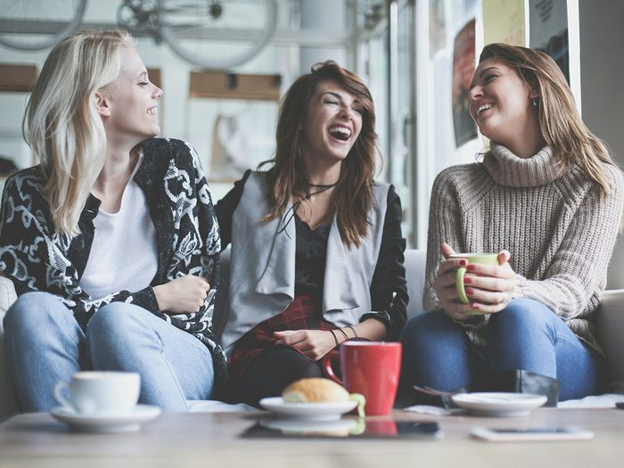 Intelligence, group of women having coffee and laughing together