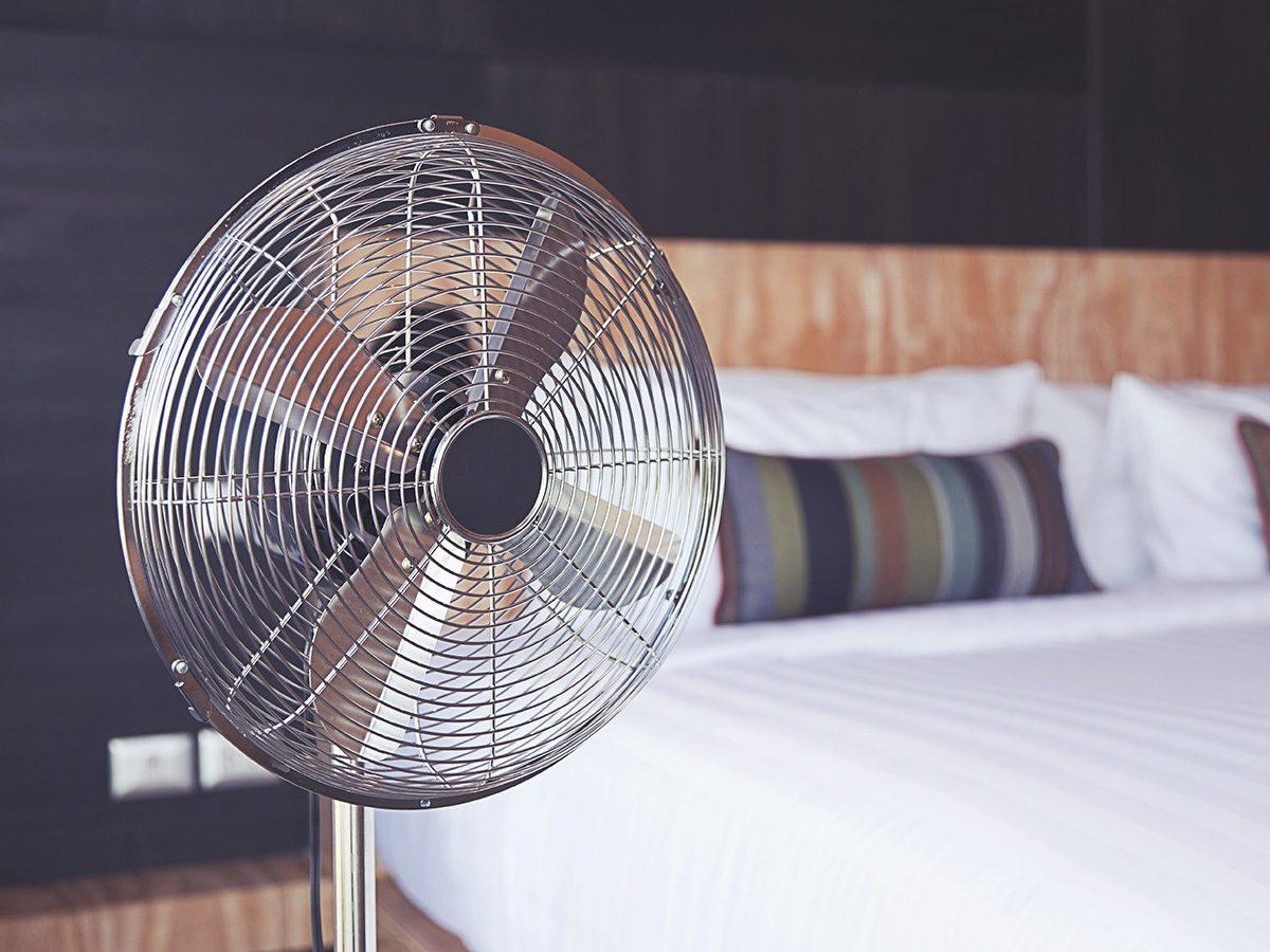 Menopause symptoms, metal fan in a bedroom