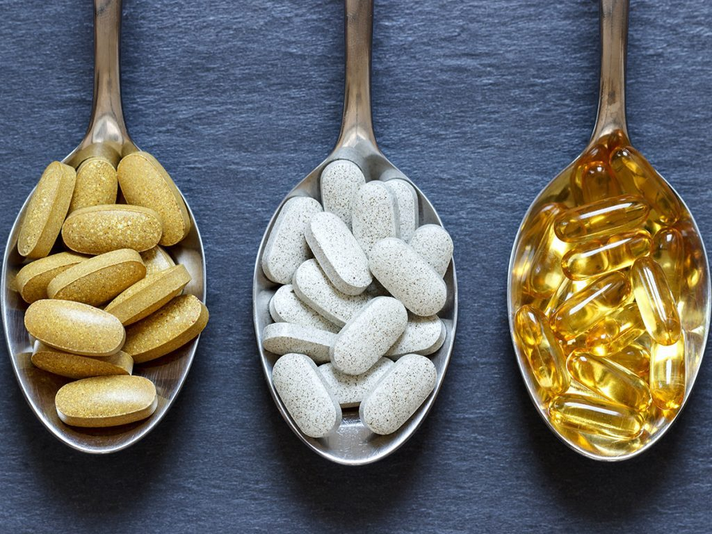 Menopause symptoms, supplements on spoons