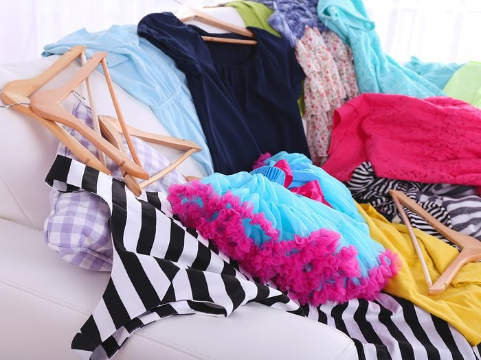 Allergies, pile of clothes on a couch