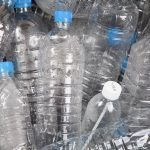 Cancer, empty plastic water bottles in a heap