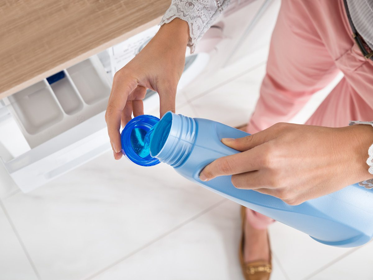 eczema, woman pouring detergent for laundry