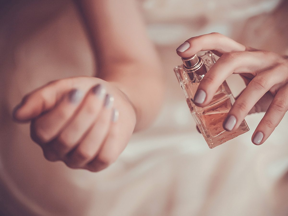 eczema, woman sprays perfume on her wrist