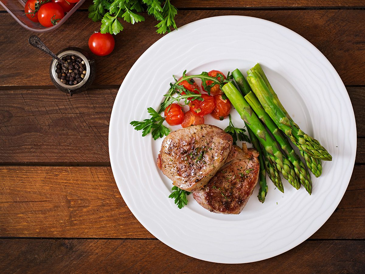 Extreme weight loss, a white plate with meat and vegetables