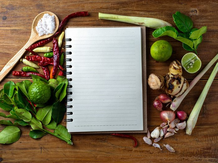 Extreme weight loss, a blank notebook surrounded by vegetables