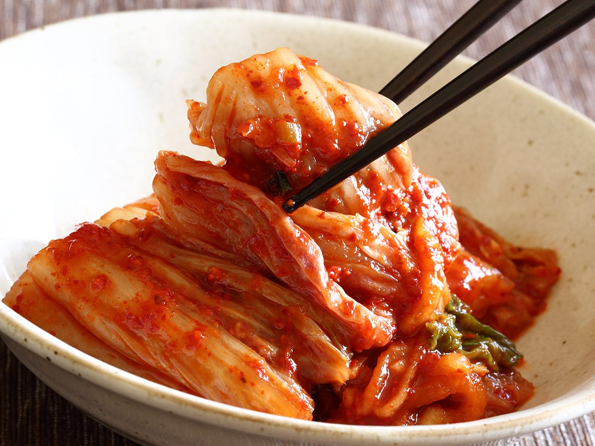 Healthy foods, bowl of kimchi with chopsticks