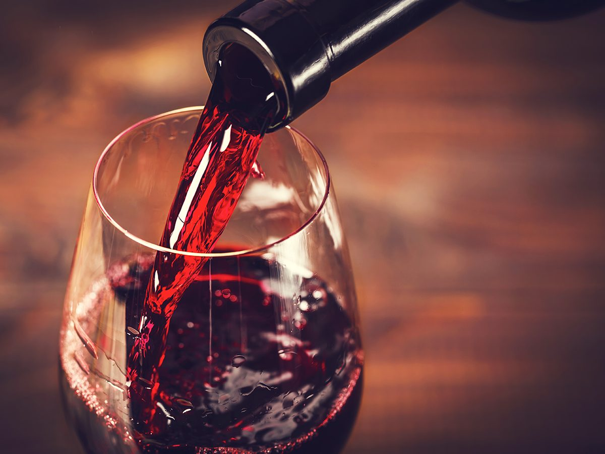 Healthy foods, a wine glass being filled with red wine