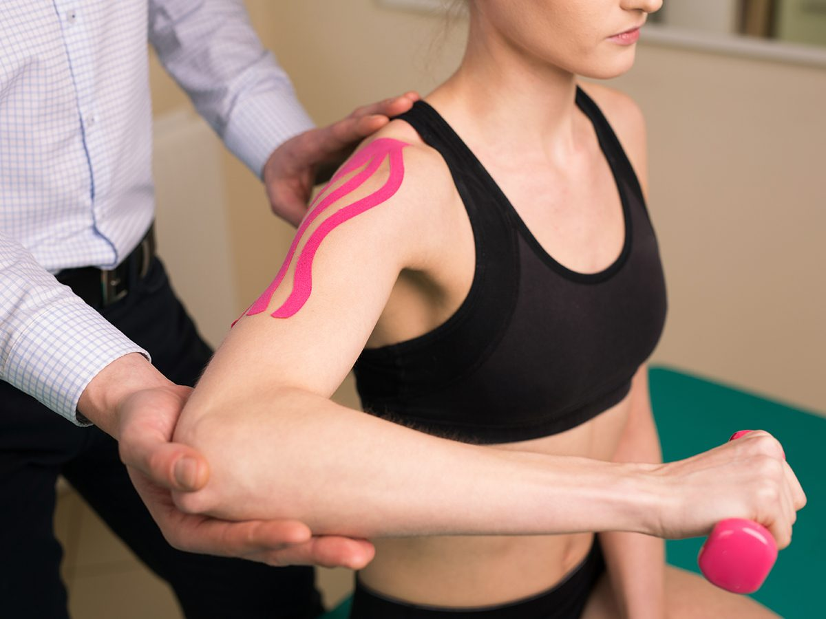 Muscle pain relief, woman getting physio for her shoulder