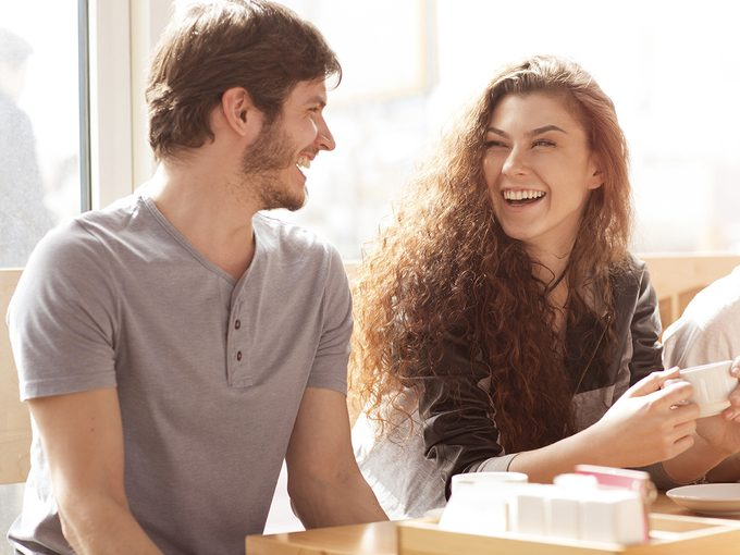 Sexual attraction, a young man and woman laughing together