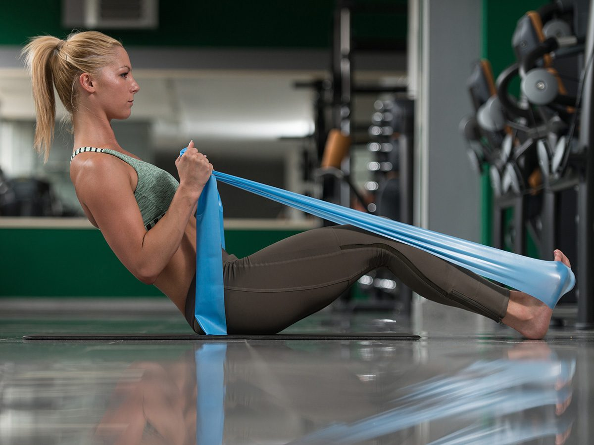 Shortness of breath, woman rowing with a resistance band
