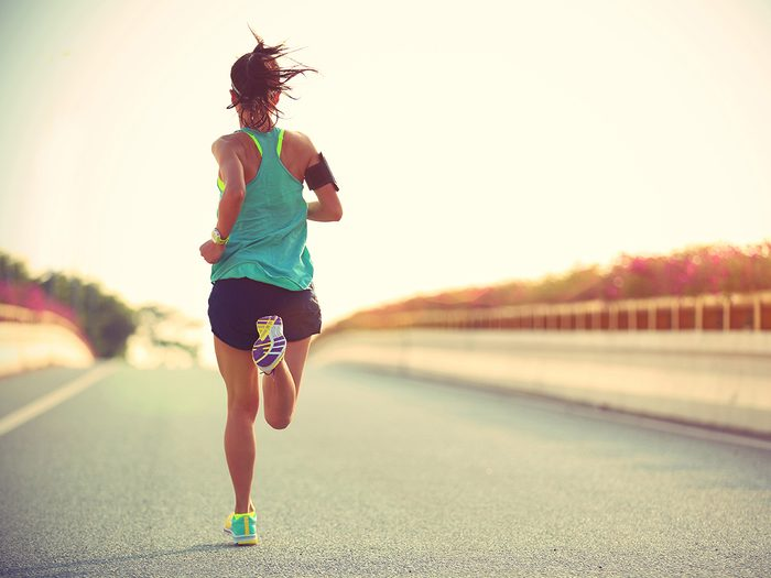 Shortness of breath, woman running on the road
