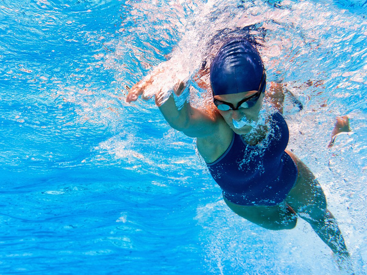 Shortness of breath, woman swimming in pool