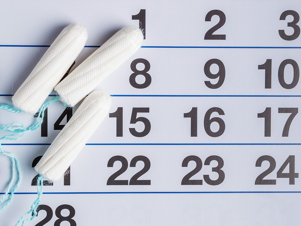 Weight gain, tampons on a calendar to signify an irregular period