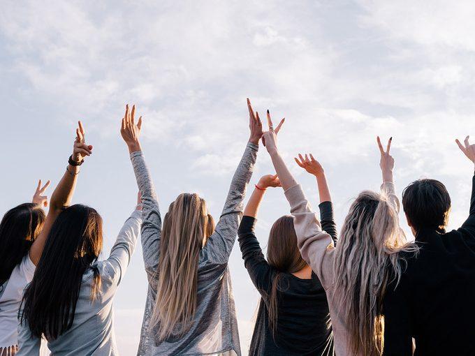Celibate empowered women standing around cheering