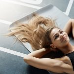 Gym Beauty Essentials, woman lying on gym floor