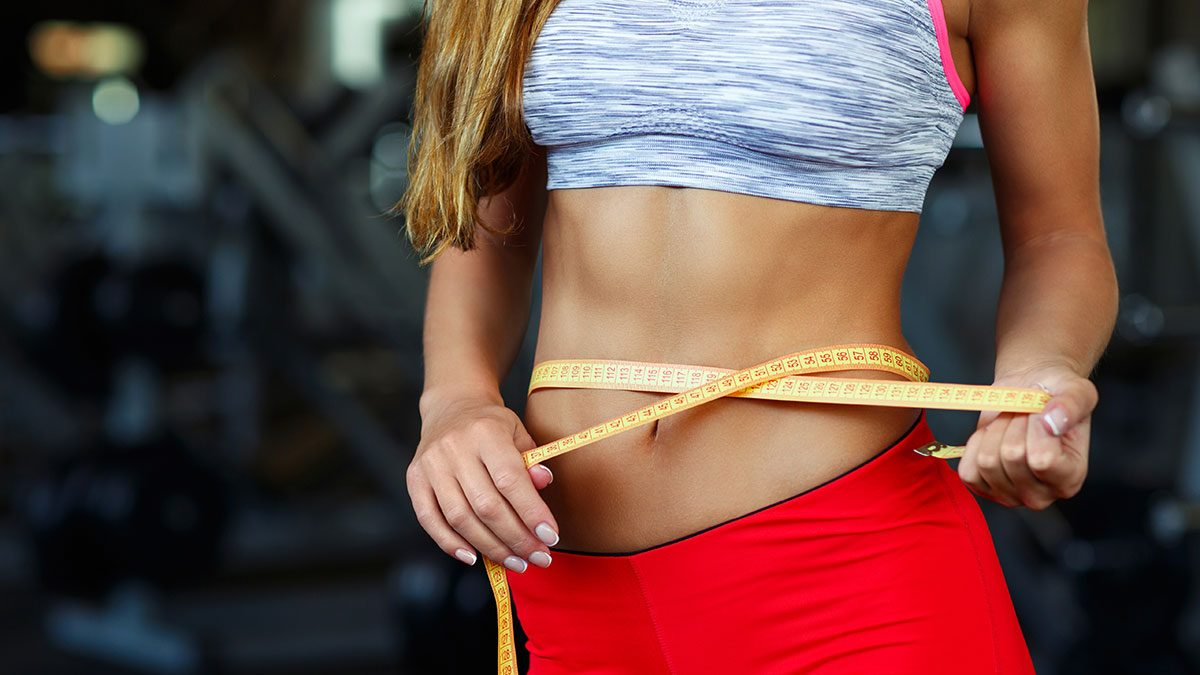 Probiotics for weight loss, woman measuring her waist