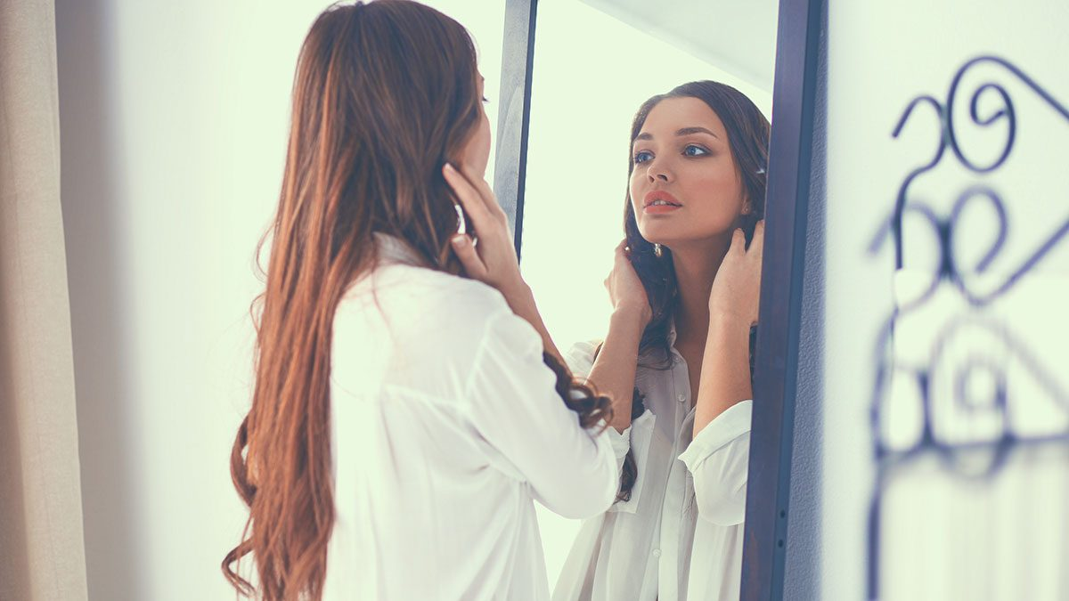 Relationship, woman looking in mirror