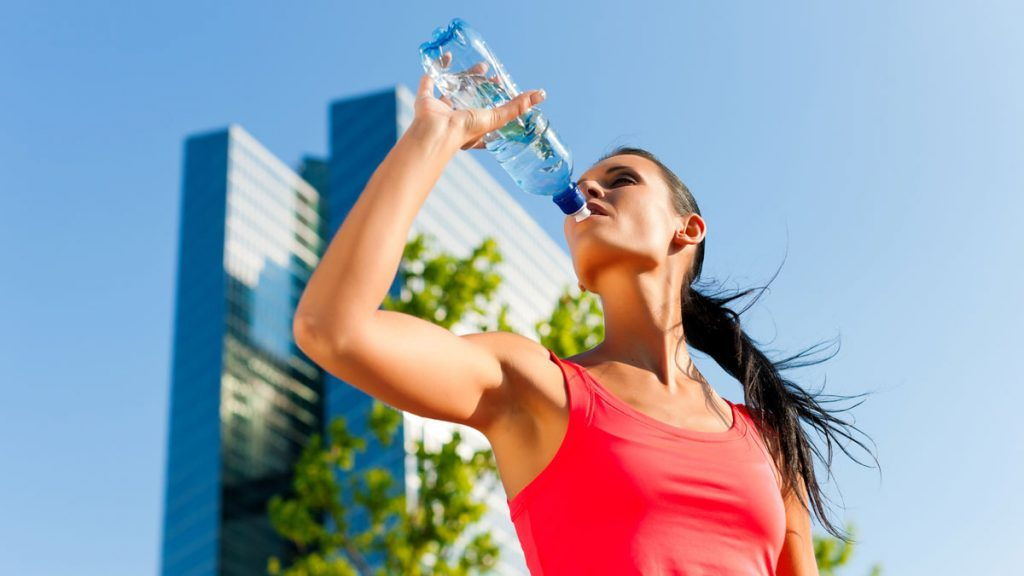 Woman drinking water for health
