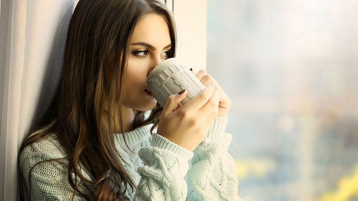 Weight Gain, woman holding coffee mug