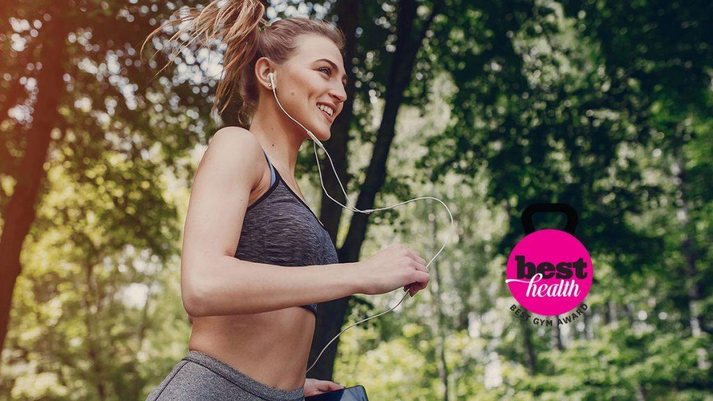 woman running in workout gear best gyms