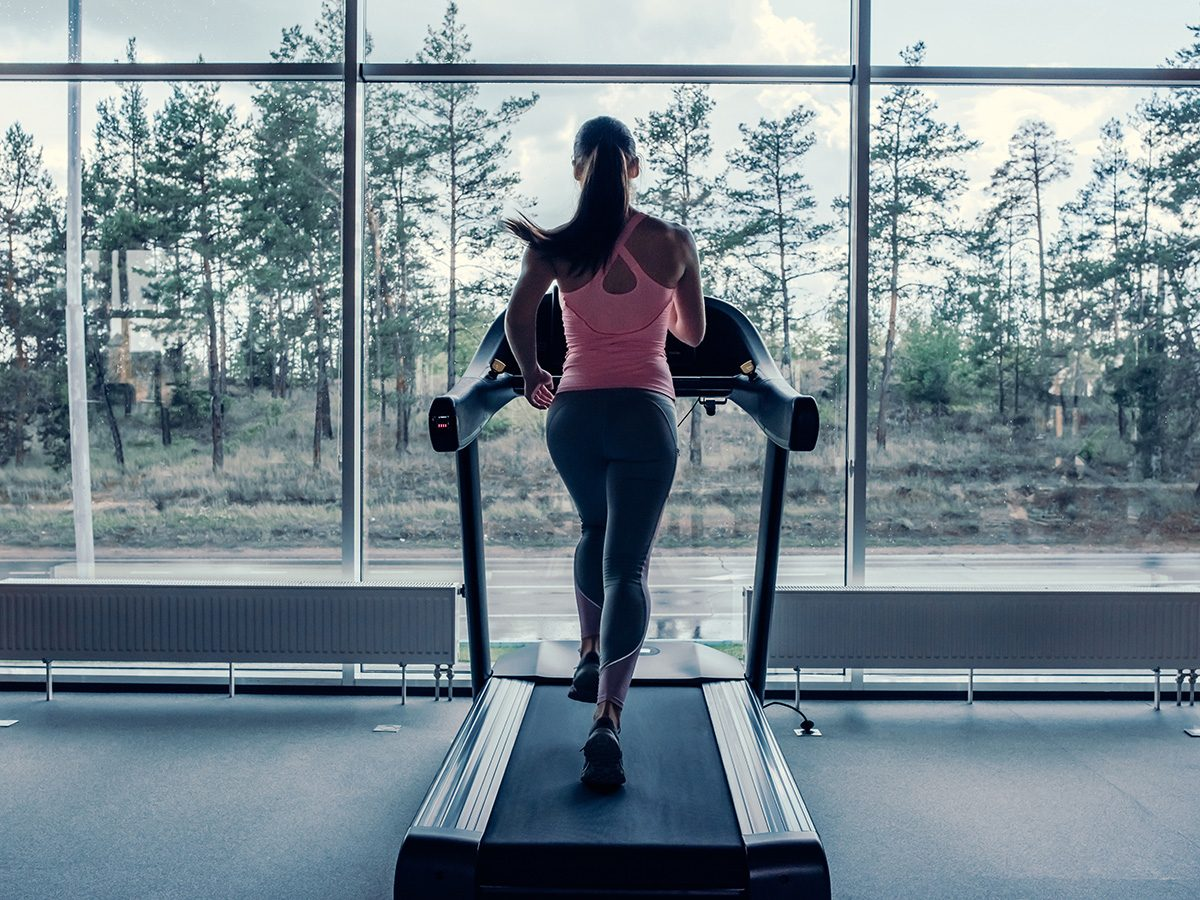 Woman completing a run on a treadmill