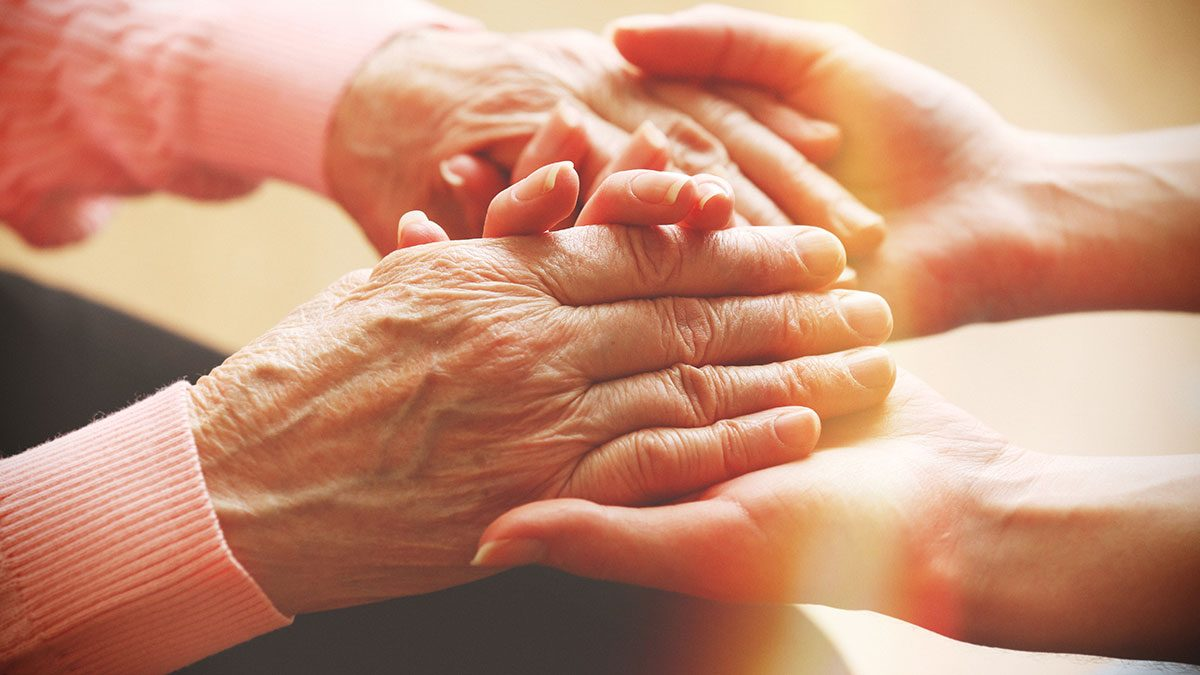 Caregiver Stress, women holding hands