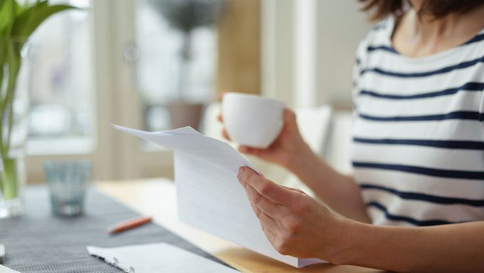 Estate Planning, woman holding papers