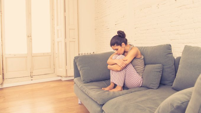 woman dealing with the physical symptoms of anxiety