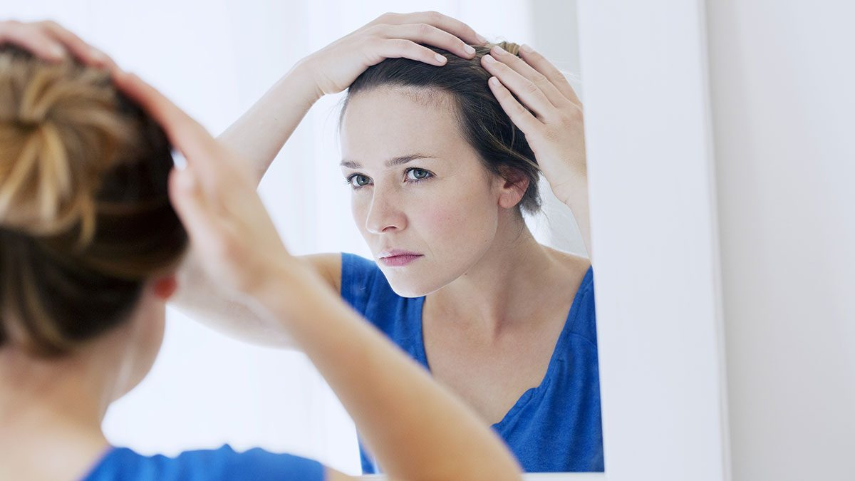 Itchy Scalp, woman looking at hair