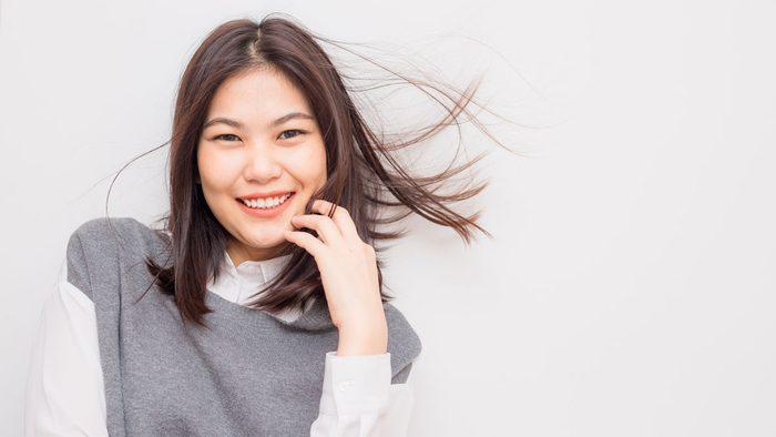 woman taking collagen pills healthy skin