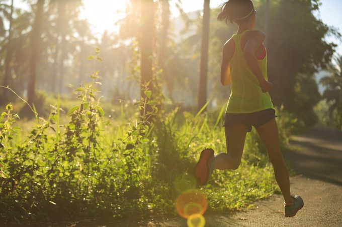 woman mindful running outside