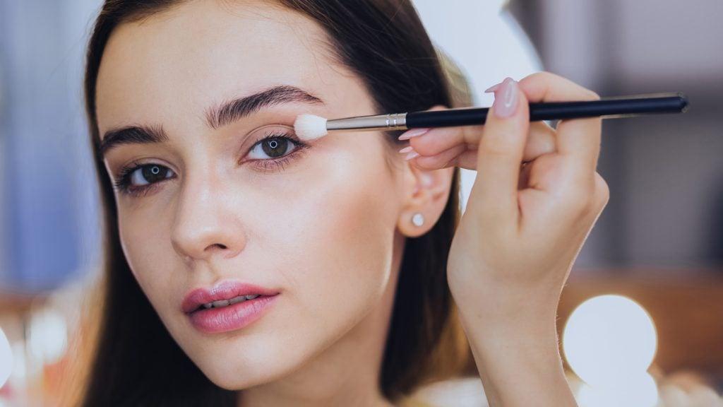 makeup application woman beauty brush
