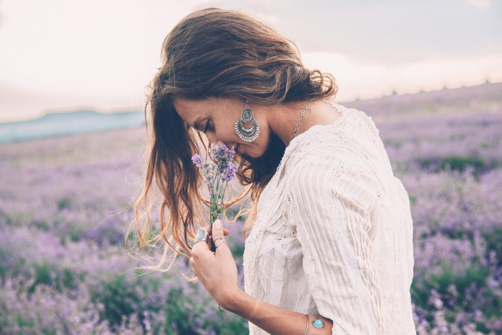 health benefits of terpenes woman smelling lavender in a field