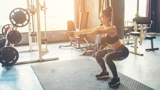 how many squats woman in the gym glute exercise
