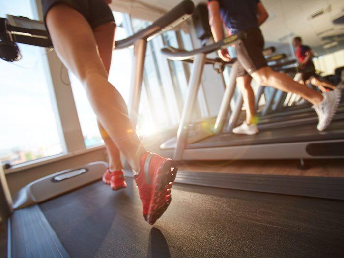women on treadmill running orangetheory class