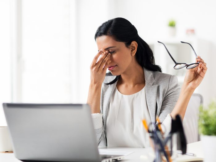 rubbing your eyes, tired, stressed working woman
