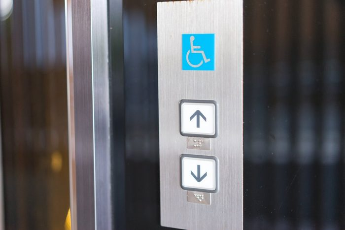 Disabled sign in the lift