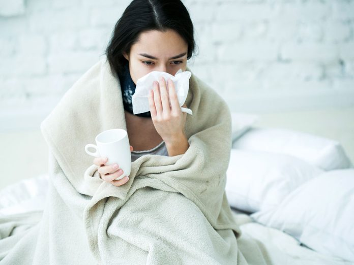 woman sick in bed