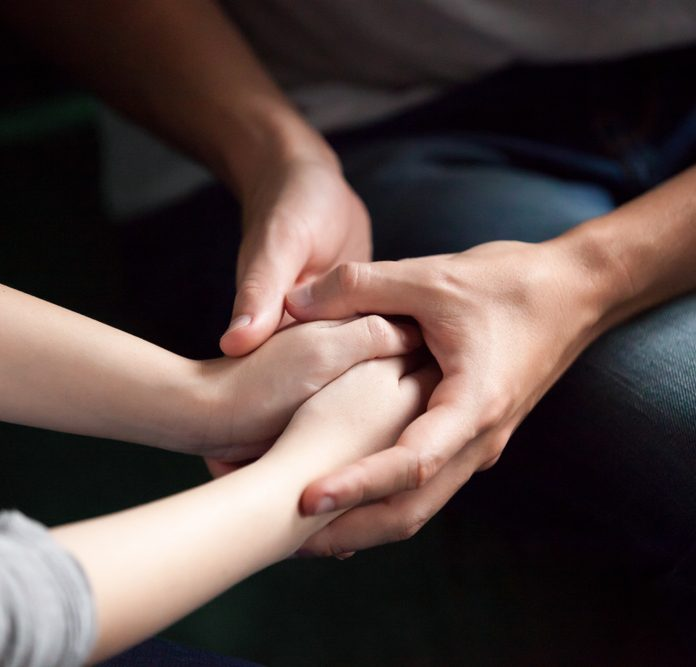how to build trust in a relationship Close up view of couple holding hands, loving caring man supporting comforting woman, giving psychological support, help or protection, understanding in marriage relationships, reconciliation concept