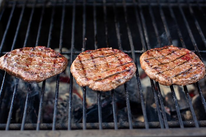 Grilled hamburger cutlets. Summer picnic with friends.