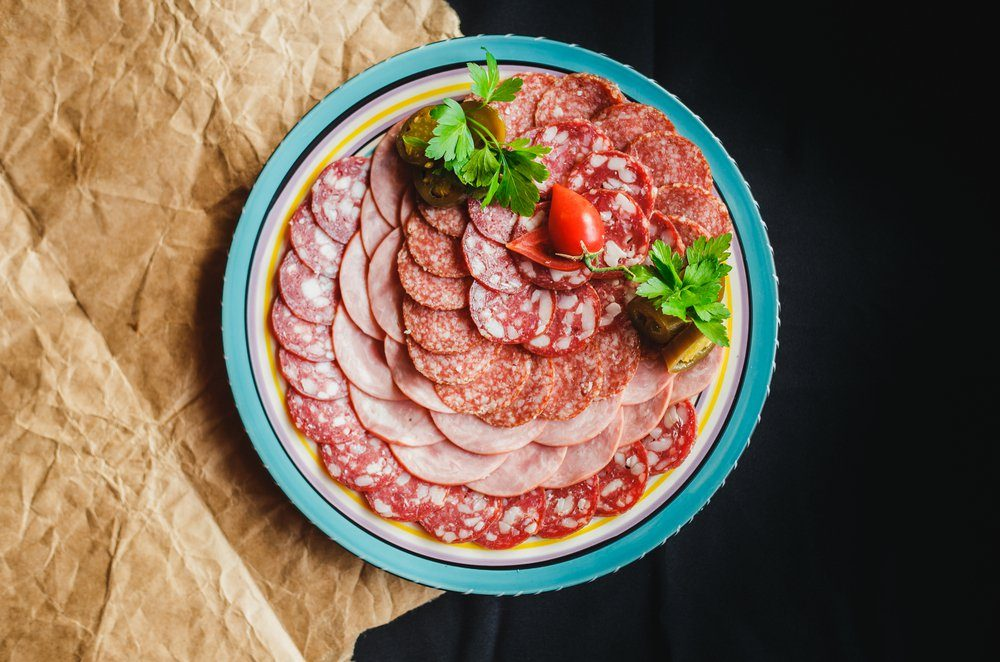 SAUSAGE CUTTING raw sausage on a plate