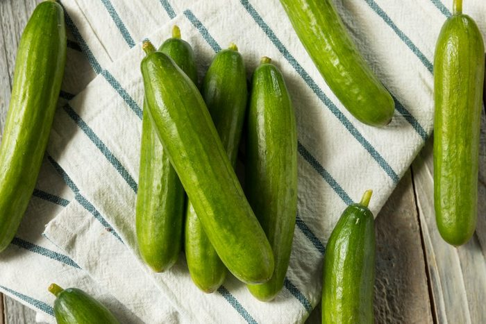 Raw Green Organic Persian Cucumbers in a Pile