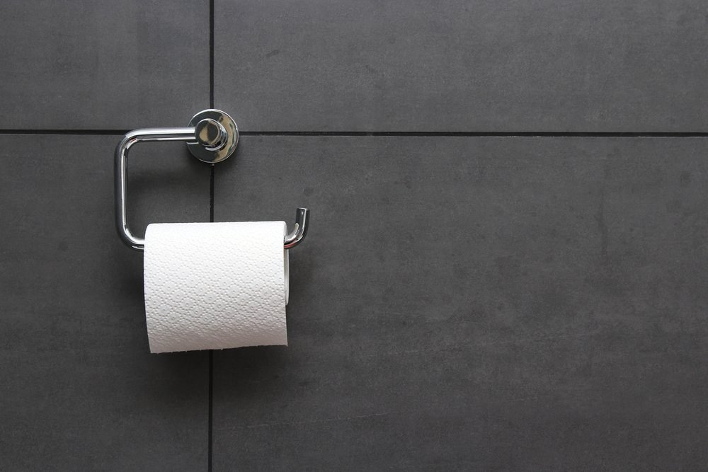 bathroom tissue on anthracite tiled wall