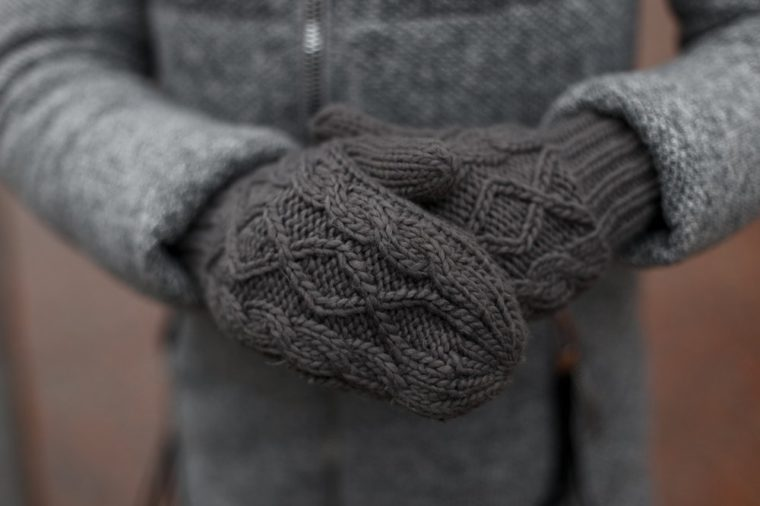 Vintage knitted gray mittens.