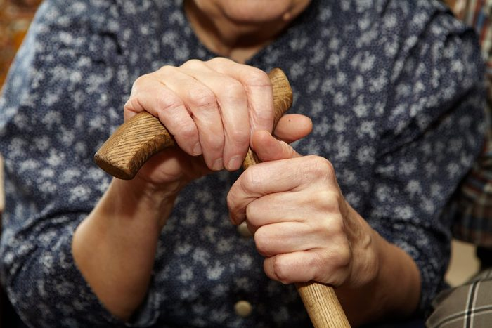 Old woman hands with cane. Senior people health care