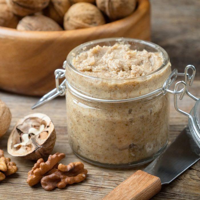 Raw organic walnut butter and fresh nuts.
